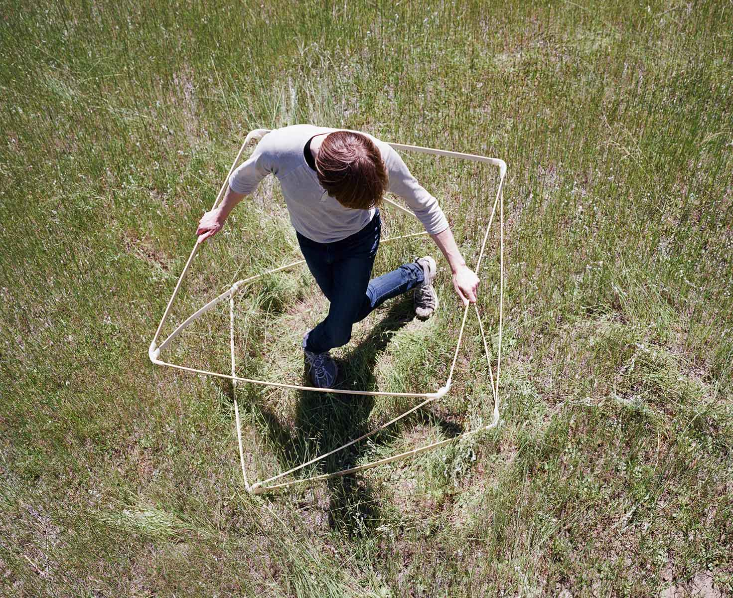 Data scientist Siobhán K. Cronin tests the geometric boundaries of designer Maria Blaisse's bamboo cube. Photo: Terri Lowenthal for Slow Research Lab