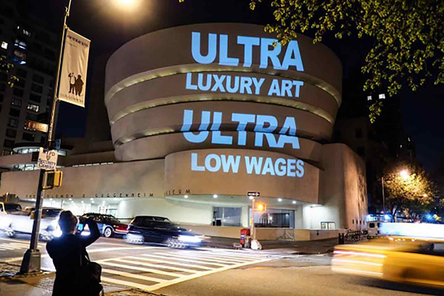 A Gulf Labor action projects slogans onto the Guggenheim Museum, New York.
