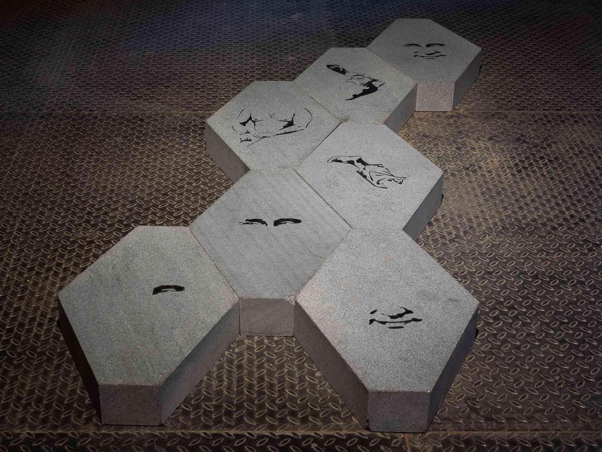 Anya Shevchenko, Putin in Every Paving Stone (2018)  Six hexagonal Zaryadaye paving stones, stencil.