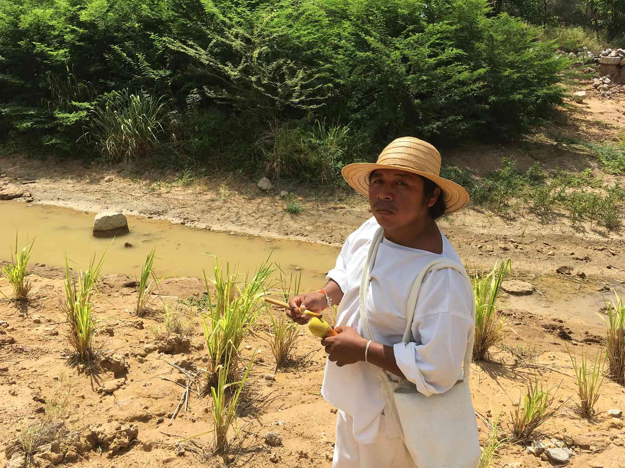 Ni con el Bruno, ni con ninguno / A member of the Wiwa indigenous people walks though the new bed of the diverted River Bruno, in solidarity with the Wayuu indigenous people affected by coal mining in La Guajira, Colombia (diana.salazar@ucl.ac.uk)
